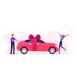 man giving car with bow as present happy vector image vector image
