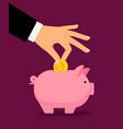 hand putting money in money box vector image