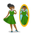 woman looking in the mirror in the dressing room vector image vector image