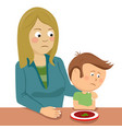 mother consoling her little son sitting at table vector image