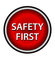 Red round safety first icon with white design vector image vector image