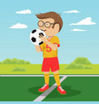 teenager boy poses with soccer ball on field vector image vector image