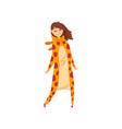 smiling girl wearing giraffe animal costume