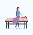 young girl having hot stone back massage masseuse vector image vector image