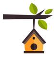 bird house hanging from a tree branch vector image vector image