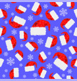 red hat and snowflakes seamless pattern vector image
