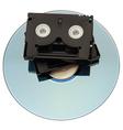 MiniDV Tape over DVD vector image vector image