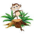 A monkey standing above a trunk vector image vector image