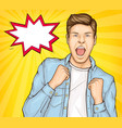 happy young man raising hands in yes gesture win vector image