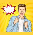 happy young man raising hands in yes gesture win vector image