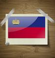 Flags Liechtenstein at frame on wooden texture vector image vector image