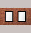 two black frames on a brick wall mock up vector image vector image