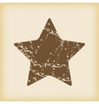 Grungy star icon vector image vector image