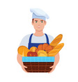 baker holds a basket with fresh bread vector image vector image