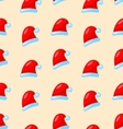 Seamless Christmas pattern Santa red hats vector image vector image