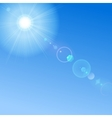 Blue sky with sun and lens flare vector image vector image