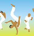 Five men are engaged capoeira on sand