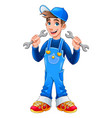 young mechanic with monkey wrenches in his hands vector image vector image