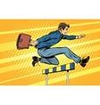 Businessman running hurdles vector image