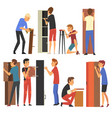 men assembling and installing new wooden furniture vector image vector image