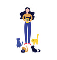woman standing with cat food box and feeding a lot vector image vector image