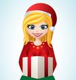Cartoon girl with Santa hat and gift vector image