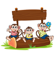 Three monkeys under the empty signboard vector image vector image