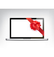 realistic laptop with red bow front view vector image
