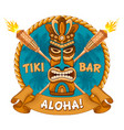 Wooden tiki mask and signboard of bar