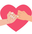 hand holding in heart shape vector image