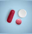 realistic capsule and a pill on a white background vector image