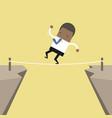 african businessman walk over cliff gap mountain vector image vector image