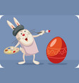 artist bunny painting easter egg cartoon vector image vector image