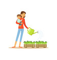 super mom character with child watering flowers vector image
