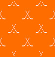 crossed hockey sticks and puck pattern seamless vector image vector image