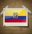 Flags Ecuador at frame on wooden texture vector image vector image