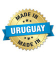 made in uruguay gold badge with blue ribbon vector image vector image