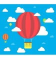 Clouds and striped hot air balloon on a blue vector image vector image