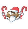 santa with candy bundt cake mascot cartoon vector image vector image