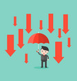 businessman hold an umbrella with down arrow rain vector image vector image