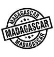 madagascar black round grunge stamp vector image vector image