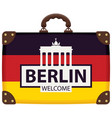 travel bag with german flag and brandenburg gate vector image vector image
