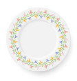 plate with a pattern of lilies on a white vector image vector image