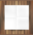 White folded paper mockup card isolated on wood vector image vector image
