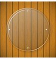 Round glass plate on the background of wooden wall vector image vector image