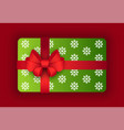 present in box with snowflakes print on wrapping vector image vector image