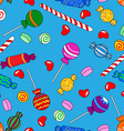 Seamless candy pattern over blue vector image vector image