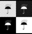 umbrella and rain drops icon isolated on black vector image