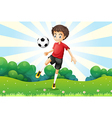 A boy practicing soccer at the hilltop vector image vector image