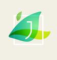 j letter logo in square frame at green leaves